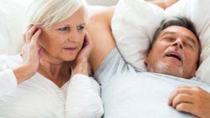 Man with Sleep Apnea Snoring Next to Spouse